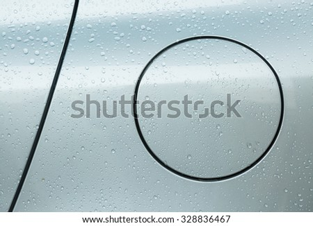 Circle cover fuel tank of car with raindrops