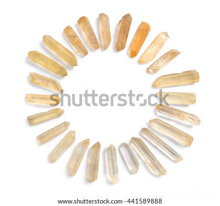 Circle frame of Lemurian quartz gemstones, isolated on white background. Powerful healing Lemurian Seed crystals with spiritual energy in circle arrangement. - stock photo