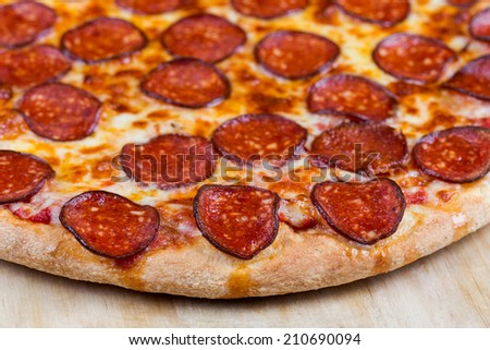 circle hot pizza close up top view - stock photo