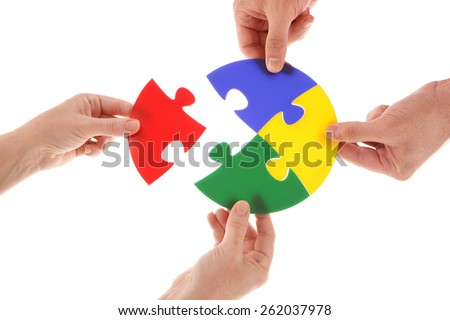 Circle Jigsaw puzzle in hands - stock photo