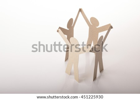 circle joining of four paper figure in hand up posture on white background - stock photo