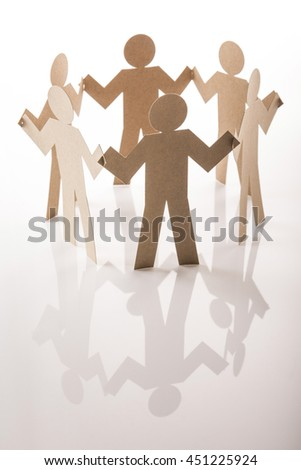 circle joining of six paper figure in hand down posture on white background - stock photo