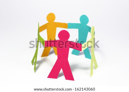 circle of colorful paper people on white background - stock photo