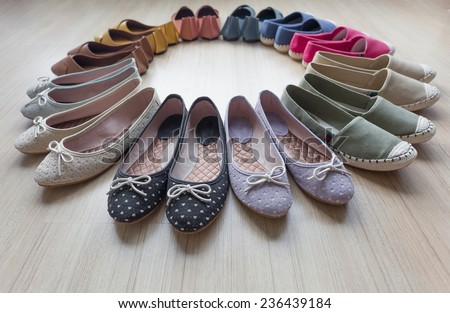circle of colorful shoes, fabric and leather shoes frame on the wood floor,unique,cute and trendy of  handmade  - stock photo