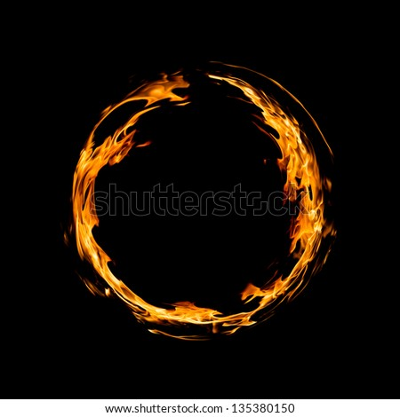 Circle of fire over black background - stock photo