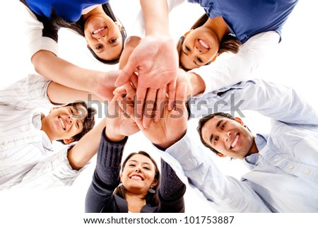 Circle of friends with hands together in the middle - teamwork concepts