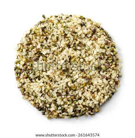 Circle of shelled hemp seeds isolated on white background - stock photo