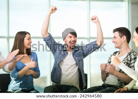 Circle of trust. Group of people are sitting in circle and supporting each other. - stock photo
