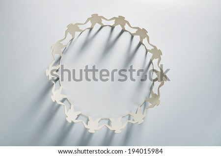 Circle of white business men paper cut-out figures - stock photo