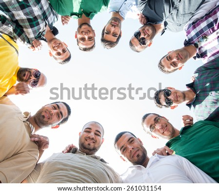 Circle of young happy people - stock photo