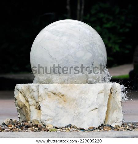 Circle shape of the fountain stones in garden. - stock photo
