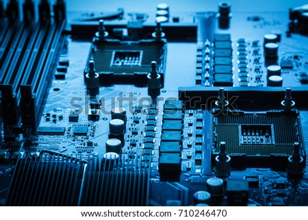 Circuit board background blue texture dark design computer concept technology motherboard chip processor