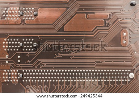 Circuit Board Texture And Pins On Computer Motherboard - stock photo