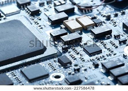 Circuit board with electronic components - stock photo