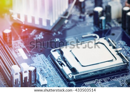 Circuit board with electronic components. Computer and networking communication technology concept. Tinted image. - stock photo