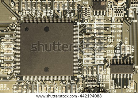 Circuit board with microchips and electronic components. Computer and networking communication technology concept. Tinted image. - stock photo