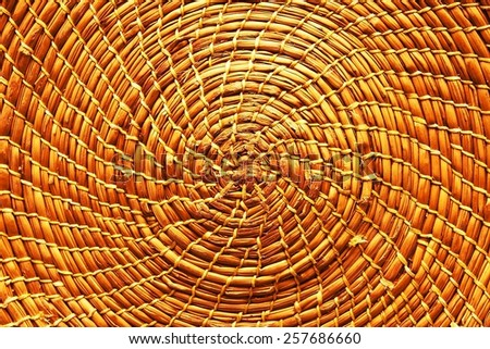 Circular background from rattan fibers. Wicker texture close-up photo. (filter image) - stock photo