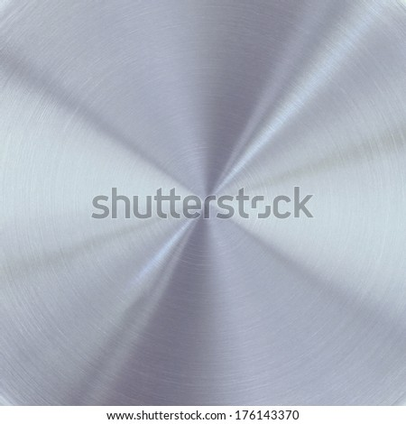 Circular brushed metal texture background of metal plate with reflections  - stock photo