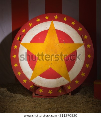 Circular disc with star in a retro circus