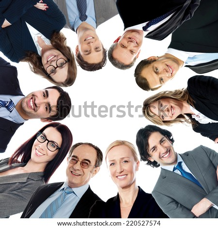 Circular formation of smiling business people - stock photo