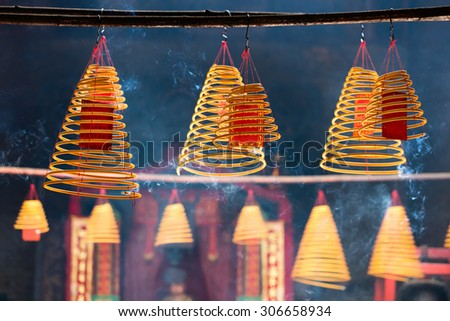 Circular incenses burning in Chinese temple in Macau - stock photo