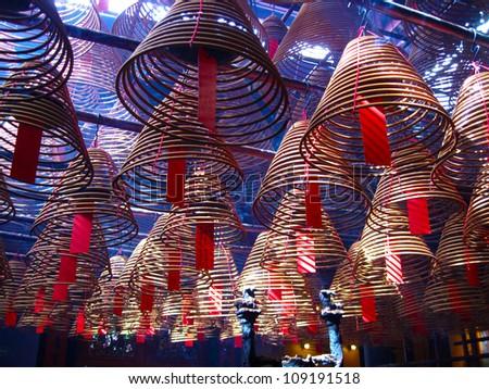 Circular incenses burning, Man Mo Temple, Hong Kong, China - stock photo