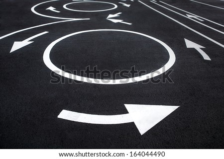 Circular motion road markings / photography of road markings and traffic symbol on surface road  - stock photo