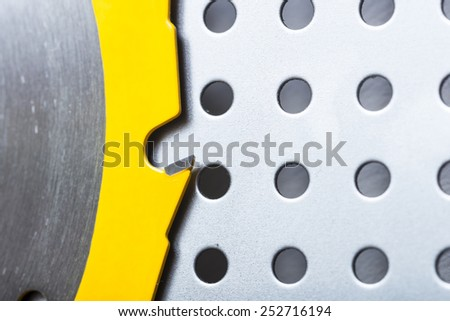 Circular saw blade on a pegboard.