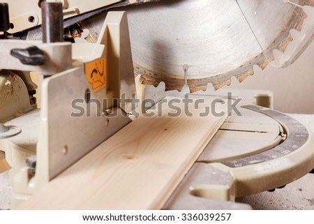 Circular Saw Cutting a Wood Plank.
