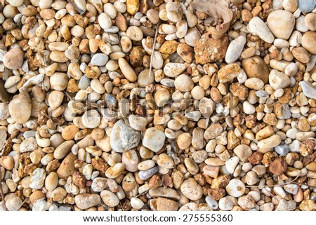 Circular sea pebbles texture background - stock photo