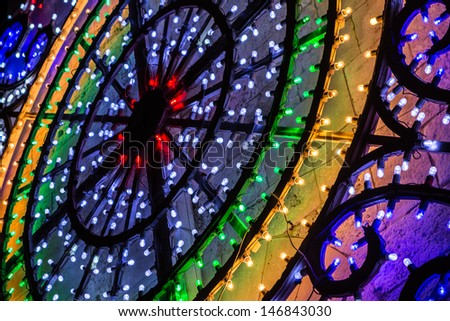 circular shaped christmas or festival lights by night - stock photo