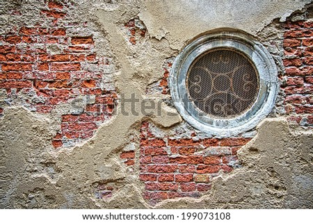Circular window in an old wall, Venice Italy