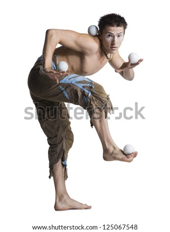 Circus juggler on white background - stock photo