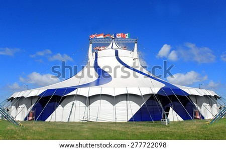 Circus tent in a field on a summer day. - stock photo