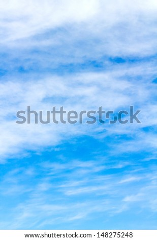 Cirrus Clouds Against a Blue Sky - stock photo