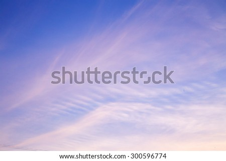 Cirrus clouds in evening sky. Sunset - stock photo