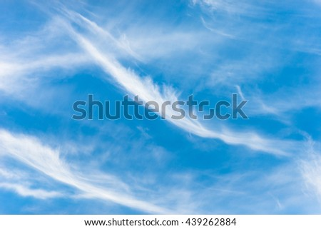 Cirrus clouds in the blue sky of Crete. The clouds looks like thin, wispy strands, The photo is taken on Crete, Greece, The clouds forms in altitudes above 5000 m - stock photo