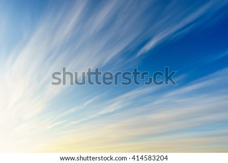 Cirrus clouds on deep blue morning sky
