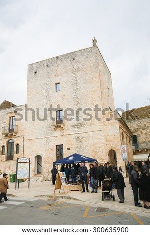 CISTERNINO, ITALY - MARCH 15, 2015: Torre civica (12th Century) in Cisternino, a comune in the province of Brindisi in Puglia, South Italy, known for its Salento wine