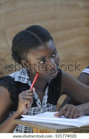 CITE SOLEIL-AUGUST 25:A female student listening to an english class in a community school in Cite Soleil-one of the poorest area in the Western Hemisphere on August 25 2010 in Cite Soleil, Haiti. - stock photo