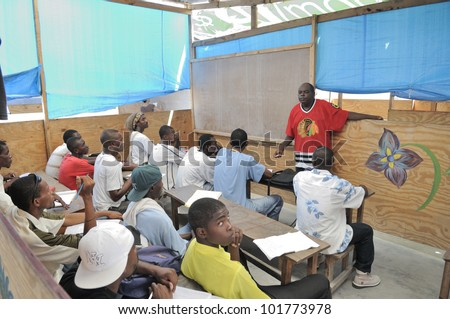 CITE SOLEIL- AUGUST 25:Joe, the english teacher teaching english in a local community school in Cite Soleil- one of the poorest area in the Western Hemisphere on August 25 2010 in Cite Soleil, Haiti. - stock photo