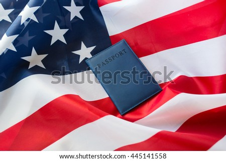 citizenship, patriotism and nationalism concept - close up of american flag and passport - stock photo