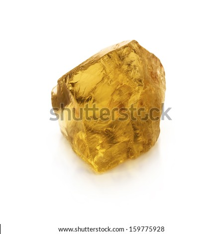 Citrine rock isolated on the white background. Raw, uncut, hi-quality yellow gemstone. - stock photo