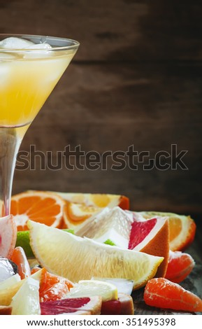 Citrus cocktail with ice and slices of fruit, selective focus