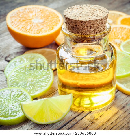 Citrus essential oil and slice of ripe fruits: orange, lemon and lime fruits - stock photo