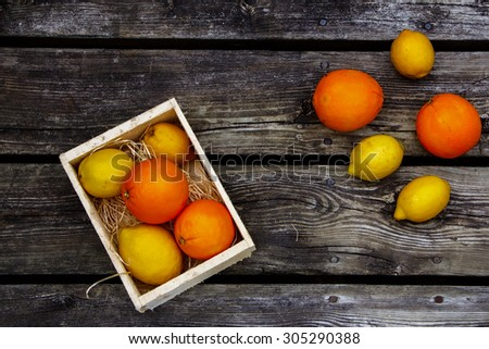 Citrus fresh fruit on rustic wooden background with space for text. Top view. - stock photo