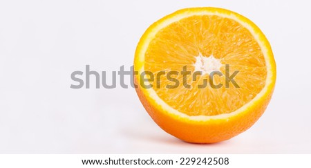Citrus fresh fruit on white background. Macro of a half of orange.