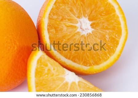 Citrus fresh fruit on white background. Macro of a half of orange. - stock photo
