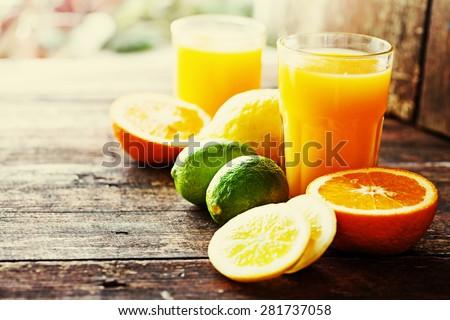 Citrus fruit and juice/ multy fruit juice / Selective focus - stock photo