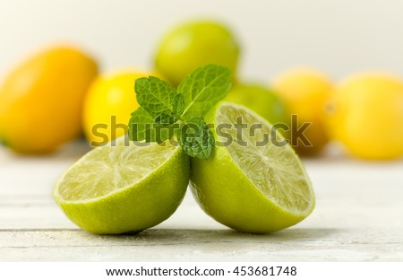 Citrus fruit still life against a grunge textured background - stock photo